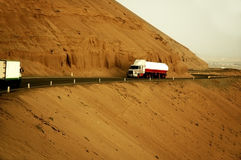 Trucks on mountainside road Royalty Free Stock Image