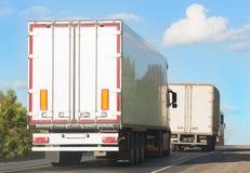 Trucks move on  mountain road Stock Image