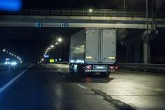 Trucks move on a night. Freeway Stock Images