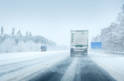 Trucks moving on a motorway. In blizzard royalty free stock photos