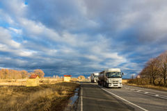 Trucks moving by the road Royalty Free Stock Photography
