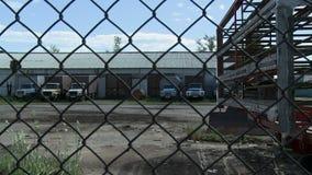 Trucks near garage and wire stock footage