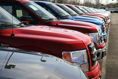 Trucks in new car lot Stock Images