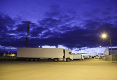 Trucks at night. Trucks in a parking. Plenty of copyspace Stock Photos