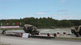 Trucks. NIZHNY TAGIL, RUSSIA - AUG 23: Trucks Ural on the stripe of obstacles at exhibition RUSSIAN DEFENCE EXPO 2012 on August, 22, 2012 in Nizhny Tagil, Russia stock footage