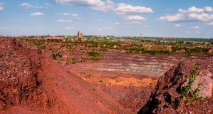 Trucks at open-cast mine in Kryvyi Rih, Ukraine. Open coal mining pit with heavy machinery in Kryvyi Rih, Ukraine Royalty Free Stock Photo
