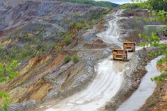 Trucks in open pit Stock Photography