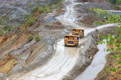 Trucks in open pit Stock Photo