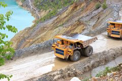 Trucks in open pit Royalty Free Stock Photo