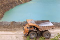 Trucks in open pit Royalty Free Stock Images