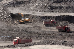 Trucks with ore. Trucks carry ore open pit Royalty Free Stock Photos