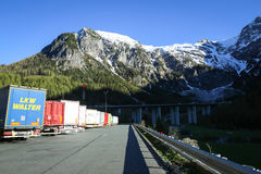 Trucks parked at rest stop. FLACHAU, AUSTRIA - MAY 10, 2017 : Parked trucks lined up at the Landzeit Tauernalm highway rest stop in Alps environment in Flachau Royalty Free Stock Photo