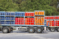 Trucks parked on a street load of propane gas tanks Stock Image