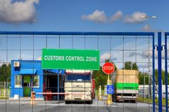 Trucks pass through checkpoint of customs logistics terminal. Lorries pass through the security checkpoint of the logistics complex with customs services Stock Images