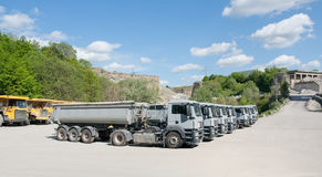 Trucks in a quarry Stock Images