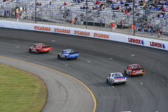 Trucks race through turn 1. NASCAR Craftsman Truck competitors roar through the 1st turn at the 2007 Fall NASCAR Truck Race at New Hampshire International Royalty Free Stock Images