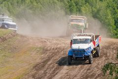 Trucks racing on unpaved sport track Stock Image