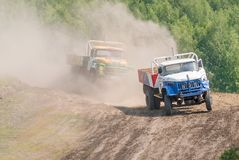 Trucks racing on unpaved track Royalty Free Stock Images