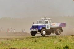 Trucks racing on unpaved track Stock Photos