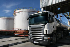 Trucks and refinery. A big chemical refinery with trucks Royalty Free Stock Photo