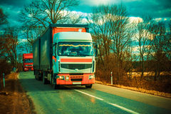 Trucks on a road Royalty Free Stock Images