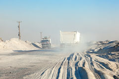 Trucks on a road in the desert of Kuwait Royalty Free Stock Photography