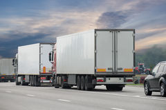 Trucks on the road. Transport on a large highway. freight transport Stock Photos