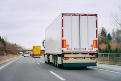 Trucks in road Trucker on highway Lorry doing logistics work. Trucks on road. Trucker on highway. Lorry doing logistics work. Semi trailer with driver. Big cargo royalty free stock photography