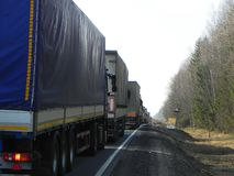 Trucks are on the road. Because of the road works, a traffic jam has accumulated on the highway. stock image