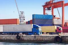 Trucks in Seaport. Transportation trucks on sea port Royalty Free Stock Images