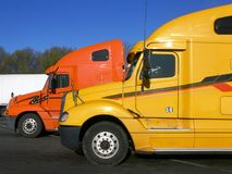 Trucks: side view of two royalty free stock photo