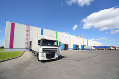 Trucks stand near warehouse of Caparol factory Royalty Free Stock Image