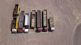 Trucks stand in a row Parking lot - top view from the drone royalty free stock photo