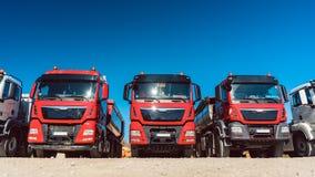 Trucks on premises of freight forwarding company. Trucks standing in line on premises of freight forwarding company royalty free stock image