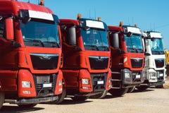 Trucks on premises of freight forwarding company. Trucks standing in line on premises of freight forwarding company royalty free stock photo