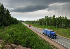 Trucks and storm weather on Highway Scandinavia. Highway Scandinavia , bad weather approaches Stock Photography