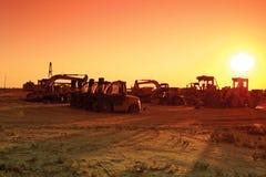 Trucks at sunset. Stock Image