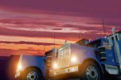Trucks in Sunset Stock Images