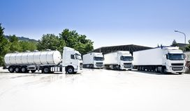 Trucks and tanker. Transport and logistics company Royalty Free Stock Images