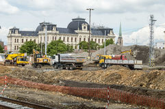 Trucks and tractors working at an under construction site Stock Photo