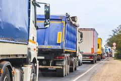 trucks in traffic jam on the road Stock Photography