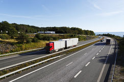 Trucks and trafic on scenic highway Royalty Free Stock Image