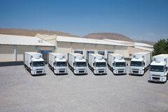 Trucks trailers at logistics warehouse Stock Photo