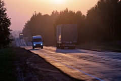 Trucks travelling on way in the morning Stock Image