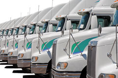Trucks Truck fleet in a row. Semi truck fleet lined up in a row of trucks stock photos
