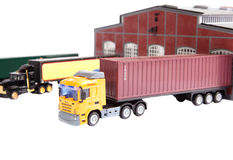 Trucks. Unloading big container trucks at warehouse building Stock Images