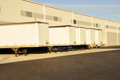 Trucks at unloading dock Royalty Free Stock Image