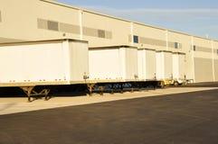 Trucks at unloading dock royalty free stock image