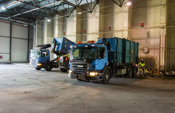 Trucks unloading garbage Stock Photo