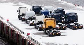 Trucks waits on snowbound pier Royalty Free Stock Photo